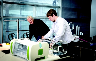 James Roberts shows Sir James Dyson his inflatable incubator