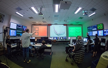 Technicians, engineers, and scientists in Advanced LIGO's Hanford, California, control room prepare for its first full-scale operational run (photo: Kim Fetrow Photography)