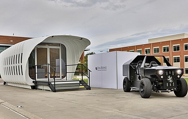 Oak Ridge National Laboratory's Additive Manufacturing Integrated Energy (AMIE) demonstration connects a 3D printed building and vehicle to showcase a new approach to energy use, storage and consumption (photo: ORNL)