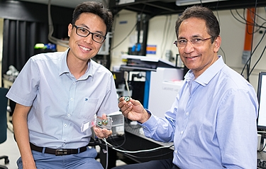 Members of the NUS research team pose with one of their new sensors (photo: National University of Singapore)