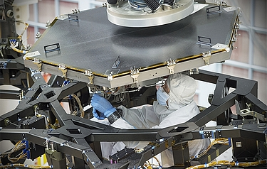 The engineering team used a robot arm to lift and lower the hexagonal-shaped segment that measures just over 1.3m across and weighs approximately 40kg (photo: NASA)