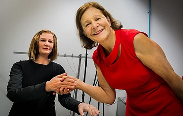 NTU Singapore's Professor Nadia Thalmann (the one in the red dress) shaking hands with Nadine (photo: NTU Singapore)