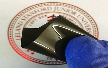 Stanford researchers have developed a thin polyethylene film that prevents a lithium-ion battery from overheating, then restarts the battery when it cools (photo: Zheng Chen, Stanford University)