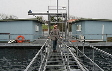 A Precision Acoustics employee ventures out onto the raft where the laboratories are located