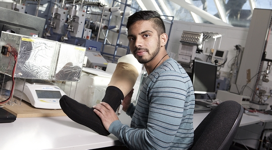 Pasindu Lugoda with a diabetic smart sock (photo: Nottingham Trent University)