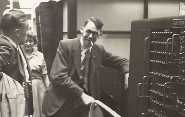Dr. Raymond Bird demonstrates the HEC at the 1953 Business Efficiency Exhibition. (Photo courtesy Dr. Raymond Bird.)