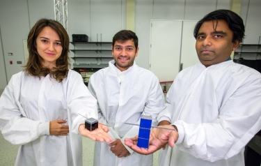 Jekan Thanga (right), assistant professor in the School of Earth and Space Exploration, worked with a team of students, including graduate aerospace engineering students Mercedes Herreras-Martinez and Aman Chandra, over two years to develop the minia