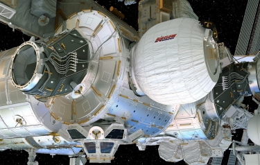 This artist's concept depicts the Bigelow Expandable Activity Module attached to the International Space Station's Tranquility module. Credits: Bigelow Aerospace