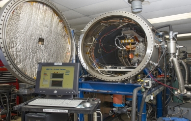 Within a controlled plasma chamber -- the High Intensity Solar Environment Test system -- tests will examine the rate of proton and electron collisions with a positively charged tether. (Credits: NASA/MSFC/Emmett Given)