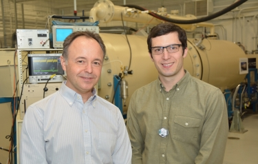 University of Michigan Professor Igor Jovanovic and Graduate Student Jason Nattress are shown in front of an ion accelerator at the Michigan Ion Beam Laboratory. (Courtesy Igor Jovanovic)