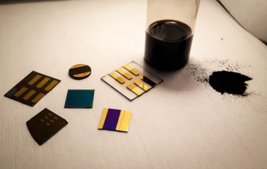 In this photo, a sample of pulverized coal (right) is shown with several test devices made from coal by the MIT researchers. (Photo courtesy of the researchers)
