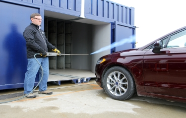 Bill Gulker, Ford wind noise core supervisor, tests a Ford Fusion at the world's first mobile aeroacoustic wind tunnel, here set up at Flat Rock Assembly Plant in Flat Rock, Michigan. (Photo: Business Wire)