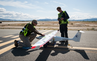 (From Left) Drone America's Todd Richman, pilot, and Kyle Pruett, engineer and pilot, prepare to test fly the Savant sUAS with cloud seeding flares at the Hawthorne Industrial Airport in Hawthorne, Nev. (Credit: Kevin Clifford, Drone America)