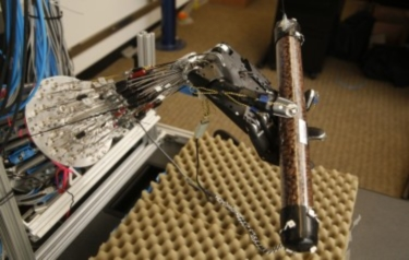 This five-fingered robot hand can learn how to perform dexterous manipulation — like spinning a tube full of coffee beans — on its own, rather than having humans program its actions. (Credit: University of Washington)