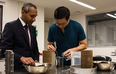 Professor Arul Arulrajah and PhD candidate Teck-Ang Kua compressed a mixture of coffee grounds and slag with a liquid alkaline solution to create a product as strong as common cement. (Credit: Swinburne University)