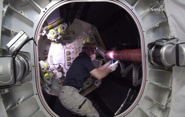 Astronaut Jeff Williams works inside the Bigelow Expandable Activity Module. (Credit: NASA TV)