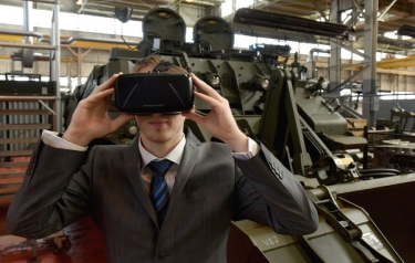 Employee tries on virtual reality headset (Credit: BAE Systems)