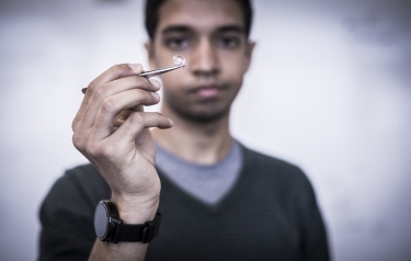 UW engineers also developed the first smart contact lens antenna that can communicate directly with devices like smartwatches and phones. (Credit: Mark Stone/University of Washington)