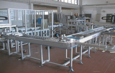 A conveyor system under construction with a safety cage being assembled
