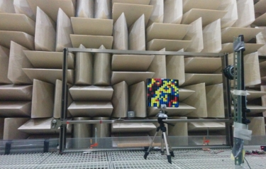 The metamaterial device is set up for testing in front of a sound-absorbing wall so that reflecting sound waves do not affect the experiments. (Credit: Duke)