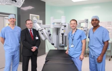 2)	Surgeons (l-r) Jim Catto, Alan Gillespie, David Yates and Derek Rosario with the Da Vinci robot