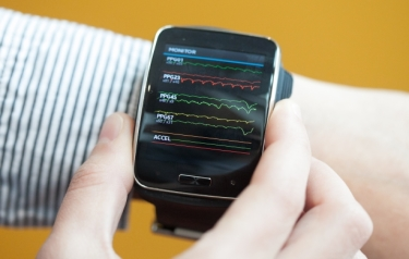 The team's system was implemented on a Samsung Simband, a research device that can measure metrics such as movement, heart rate, blood pressure and skin temperature. (Credit: Jason Dorfman/MIT CSAIL)