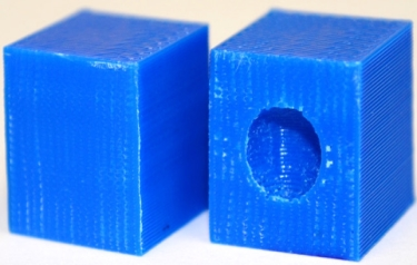 In the block on the right, the embedded sphere prints as a void if the required printing conditions are not used, giving that part lower strength. (Credit: NYU Tandon School of Engineering)