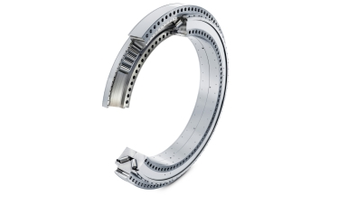 New, compact moment bearing: the double row tapered roller bearing unit in an 'O' arrangement, with grease lubrication and seals, is supplied pre-assembled.