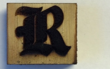 This Rice University athletics logo is made of laser-induced graphene on a block of pine. Rice scientists used an industrial laser to heat the wood and turned its surface into highly conductive graphene. (Credit: Tour Group/Rice University)