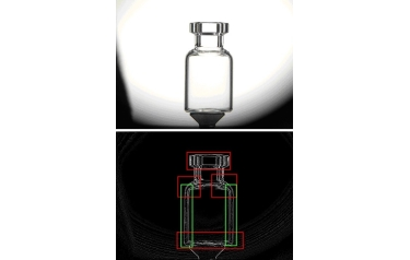 A system, used special lighting and video cameras to detect cracks and bubbles in glass bottles