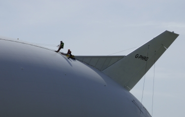 Two Technicians on top of Airlander (Credit: Hybrid Air Vehicles)