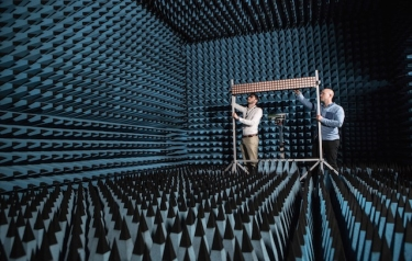 Paul Harris and Steffen Malkowsky test their 128-antenna array in the University of Bristol's anechoic chamber.