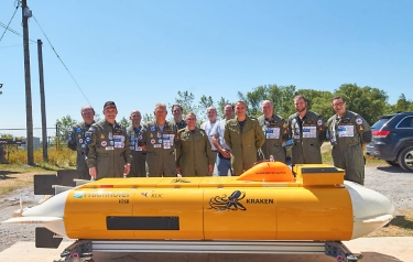 "The ""Raise the Arrow"" team gathers for a photo behind the AUV (Credit: Fraunhofer IOSB-AST)"