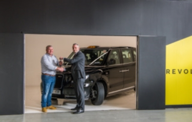 Taxi driver David Harris receives his new LEVC TX electric taxi from LEVC Customer Relationship Manager, Lorenzo Bugliari