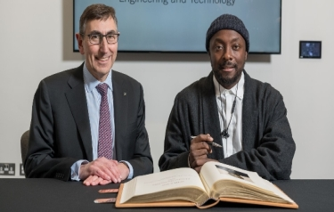 will.i.am, Honorary Fellow of the IET, signs the prestigious 'Roll of Honorary Fellows and Faraday Medallists' book, alongside Nigel Fine, Chief Executive of the IET