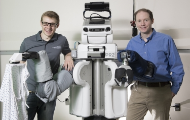 Zackory Erickson and Charlie Kemp with PR2 (Credit: Georgia Tech)