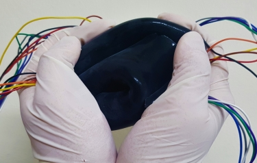 A new tough and flexible keyboard is usable even after squeezing it. (Credit: American Chemical Society)