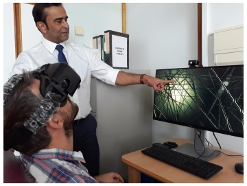 Professor Jaydip Ray with a patient using the virtual reality technology