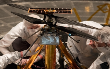 Members of the NASA Mars Helicopter team inspect the flight model (Credit: NASA/JPL-Caltech)