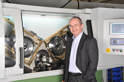 Managing director Les Reeves in front of one of the new grinding machines