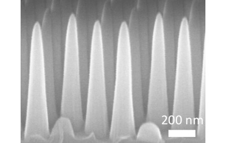 The surface pattern — consisting of an array of nanoscale cones that are five times as tall as their base width of 200 nanometers — is based on a new fabrication approach the MIT team developed using coating and etching techniques adapted from the se