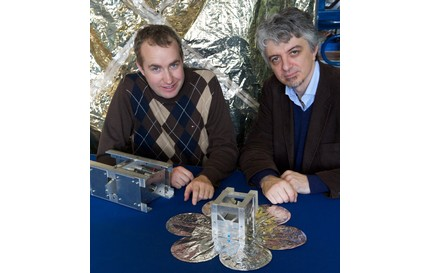 PhD student Thomas Sinn (left) and Dr Massimiliano Vasile with a test satellite