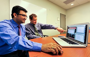 ORNL researchers Phani Teja Kuruganti (left) and James Nutaro developed the Radio Channel Simulator software