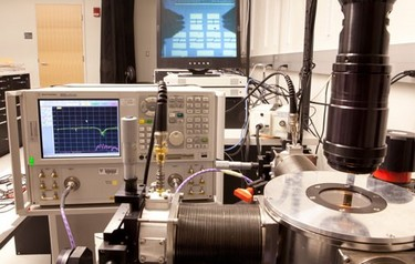 The experimental setup in Donhee Ham's lab. The metamaterials are inside the probing chamber at the bottom right. Imaged through the black microscope, they appear on the screen at the top of this image (photo by Eliza Grinnell, SEAS Communications)