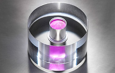 The maser core: a sapphire ring containing a reddish pink crystal that amplifies microwaves to create a concentrated beam (photo courtesy NPL)