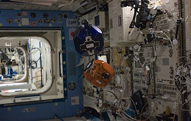 An experiment taking place inside the International Space Station (photo courtesy of DARPA)