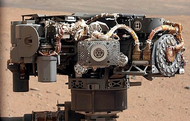 This image shows the Alpha Particle X-Ray Spectrometer (APXS) on NASA's Curiosity rover, with the Martian landscape in the background (Photo courtesy of NASA/JPL-Caltech/MSSS)