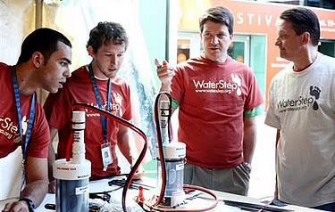 Worth his salt: Steve Froelicher, second from the right, and volunteers from GE and WaterStep built 100 chlorinators at Louisville's IdeaFestival, held earlier in September