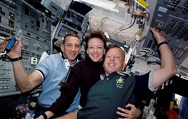 Atlantis astronauts happily shared the same air and small spaces, with a multitude of surfaces, on space shuttle mission 104 in 2001. From left: Charles O. Hobaugh, Janet L. Kavandi, Steven W. Lindsey (photo courtesy of NASA)