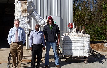 Panneer Selvam (centre), Micah Hale (left) and Matt Strasser pose before their thermocline energy storage test system